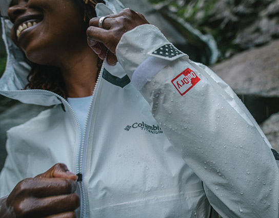 Woman in a Columbia jacket with tech logo.