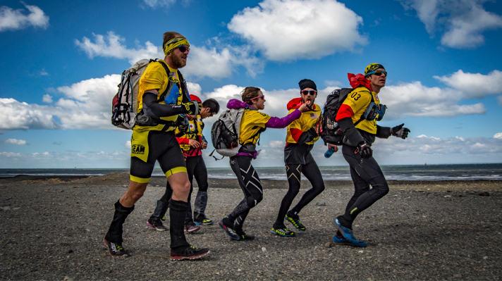 Team Bend Racing running on a rocky beach.