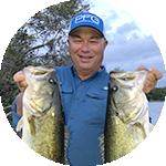 Close-up portrait of Bob Izumi in Columbia Performance Fishing Gear.