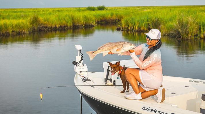 Cindy Nguyen holding up a prize catch.