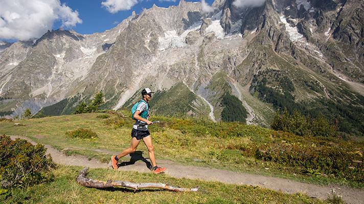 Joe McConaughy runs on a mountain trail.
