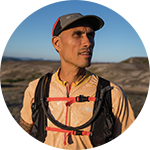 Close-up portrait of Yassine Diboun in Columbia trail running gear.