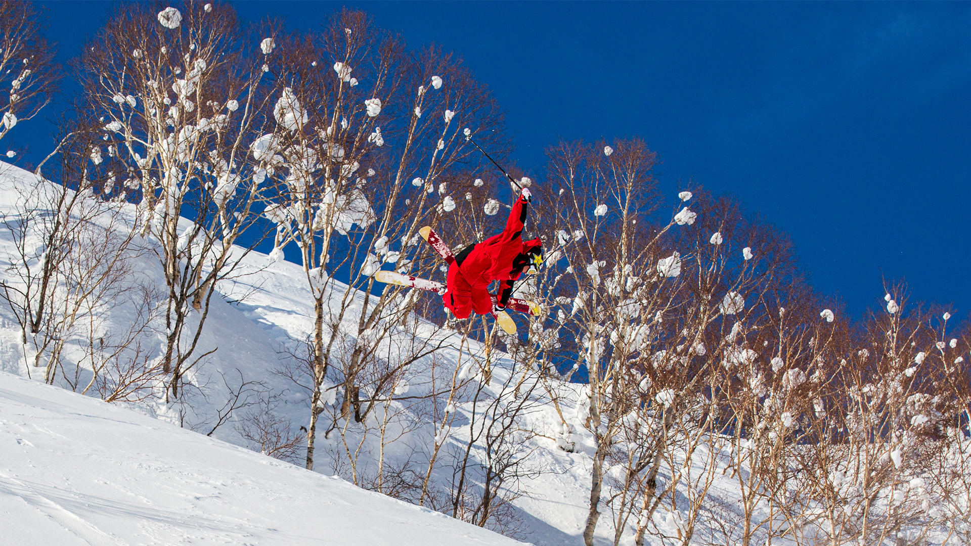 A woman skiing down a mountain slope.