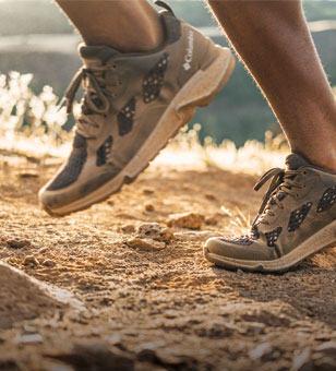A runners feet on a trail.