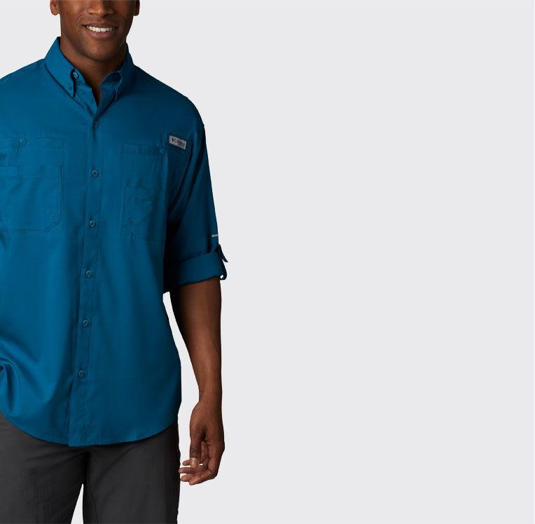 A man wearing a blue Tamiami shirt.