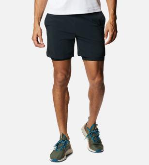 Man in dark blue shorts.