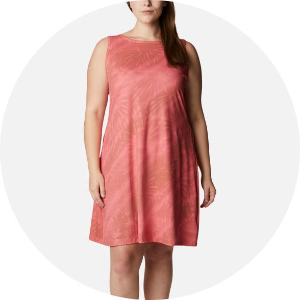 Woman in a salmon dress.