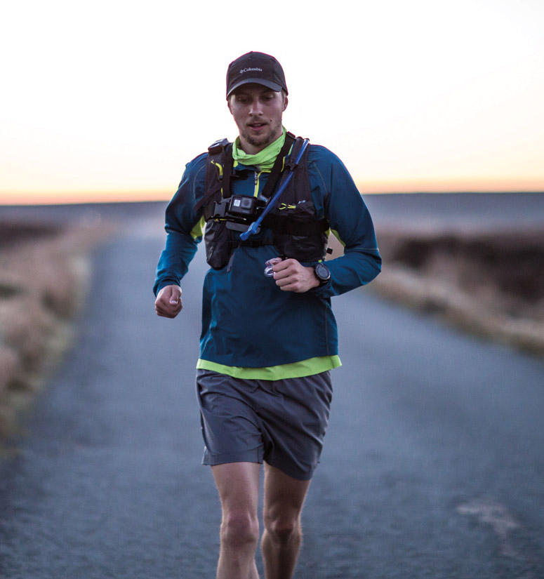 Joe Mcconaughey, ultra-trail runner in action. Play button for video about Fastest Known Time run in Ireland.