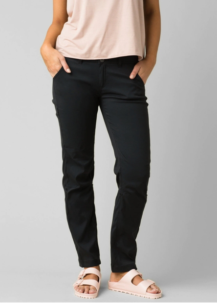 A woman wearing, black Halle Straight pants.