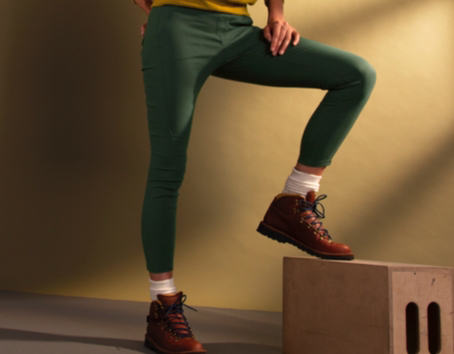 A woman stretching represents prAna's climbing styles for women.