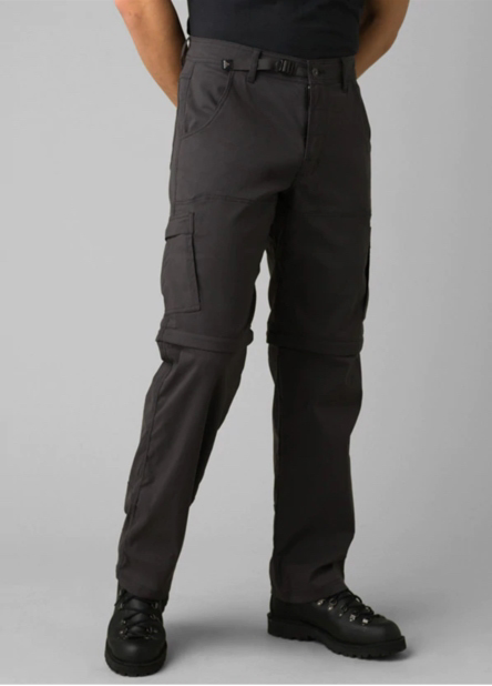 A man wearing, standard fit stretch zion convertible pant.