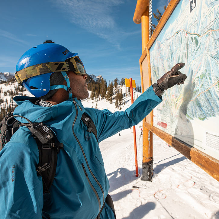 Pointing to the map of the ski resort, looking for good meet up spots