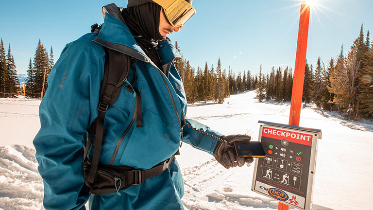 close up of scanning transmitter at an avy checkpoint in the backcountry