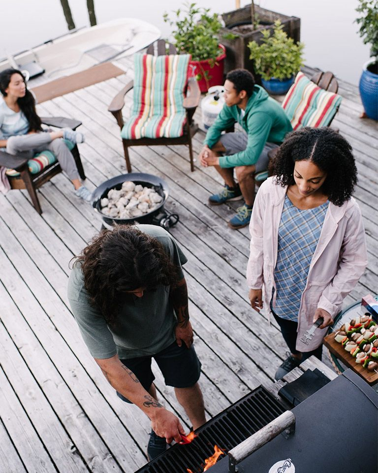 People at an outdoor BBQ party.