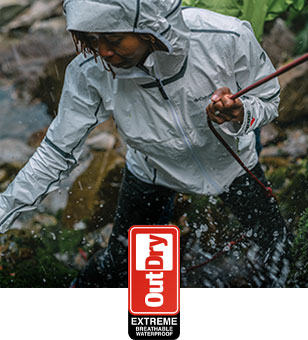 OutDry Extreme logo. A woman wearing an ODX jacket.