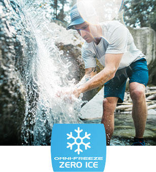 Omni-Freeze Zero Ice logo. A man in Omni-Freeze gear by a waterfall.