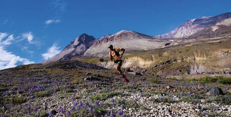 Columbia Montrail athlete Yassine Diboun running in a mountain wilderness.