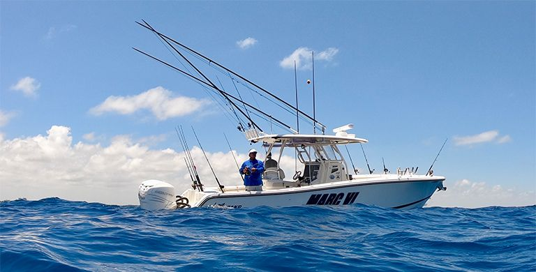 PFG athlete George Poveromo fishing from a boat.