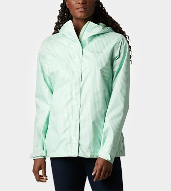 A woman in a mint-green jacket.