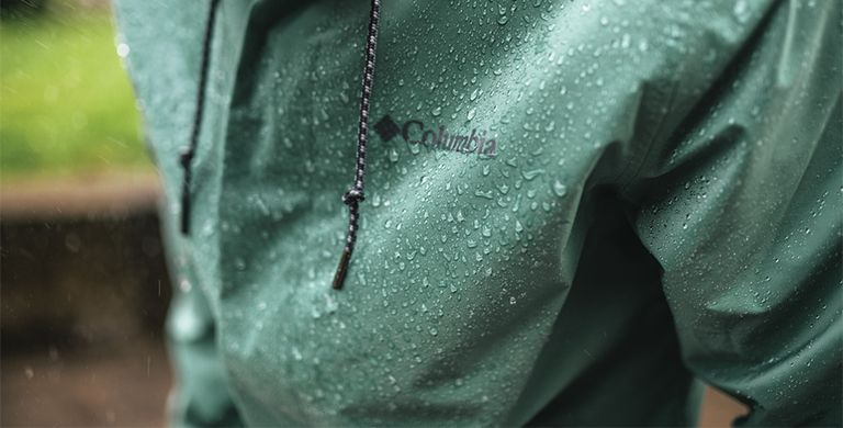 Close-up of a person in a waterproof jacket.
