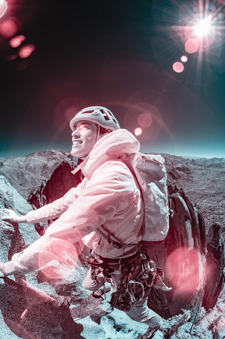 Infrared image of Mountain Hardwear athlete Miranda Oakley, nearing the top of a route in the Needles