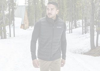 A man wearing a Columbia insulated mid layer in the snow.