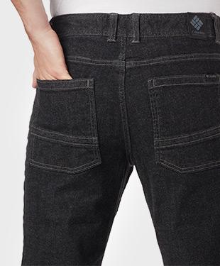 A close-up of a man wearing Pilot Peak Denim Pants.