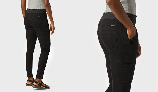 A woman wearing black Pinnacle Peak Hybrid Pants.