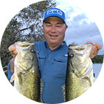 Close-up portrait of Bob Izumi in Columbia Performance Fishing Gear.