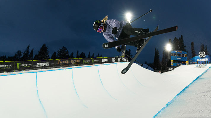 Cassie Sharpe soaring above a half-pipe course.