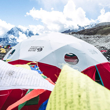 View of Everest Base Camp with a MHW Space Station Tent front and center, Everest in the background.