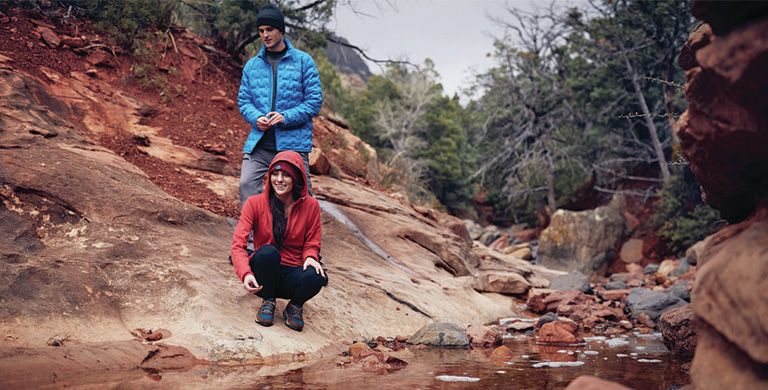 Hikers on a red clay bluff.