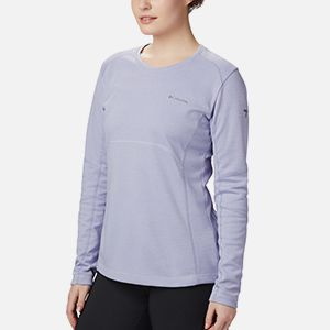 A woman in a long sleeve crew top.