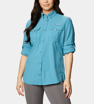 Woman in a long sleeve PFG button down shirt.