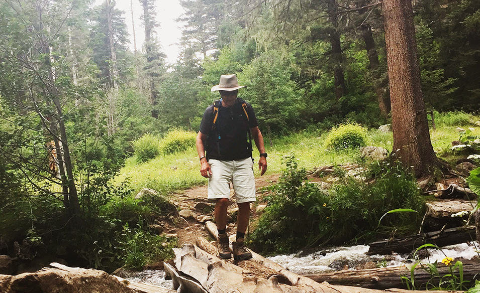 Man hiking in the woods.