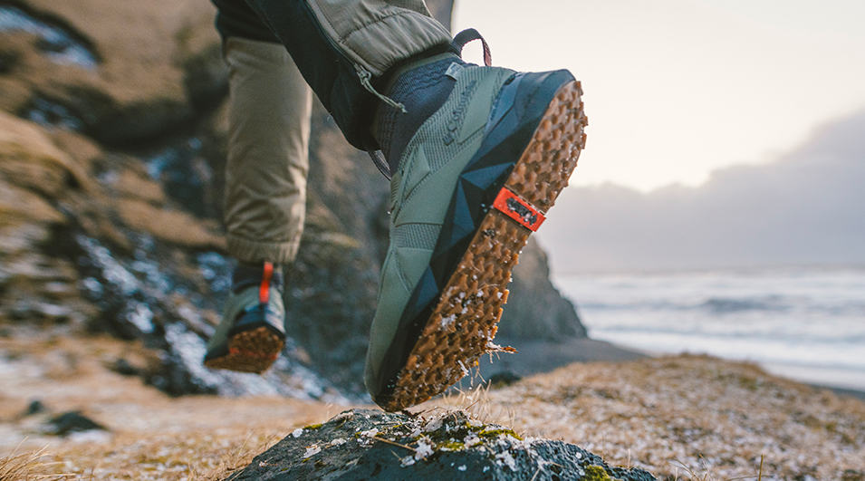 Close-up of someone hiking in outdoor sneakers.