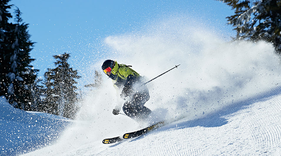 A skier carving on groomed snow.