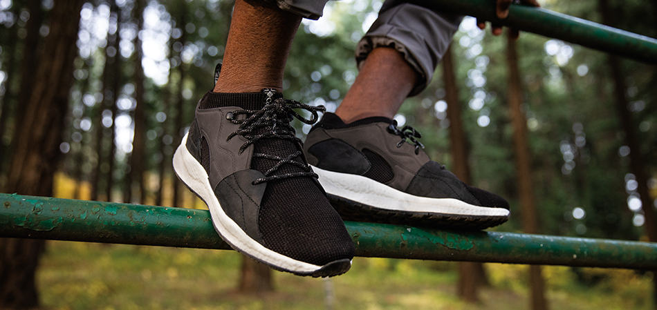 Close-up of black sneakers outdoors.