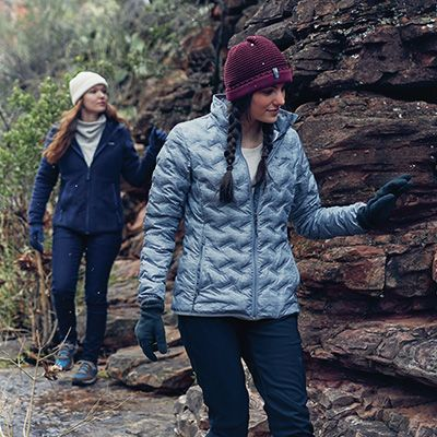 Two women exploring on a hike.