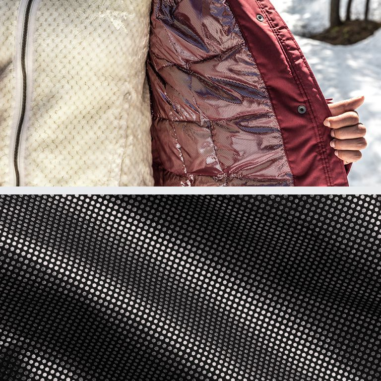 A person showing their jacket's Omni-Heat lining. Close-up of fabric with Omni-Heat.