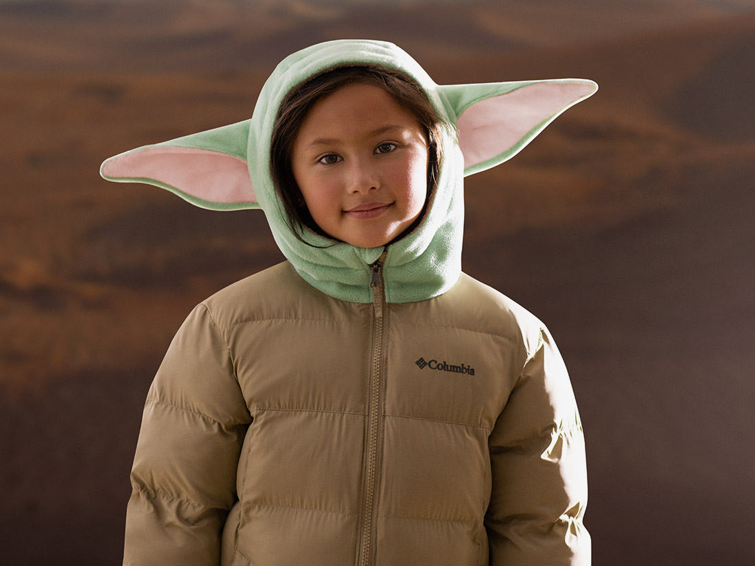 Partial view of a child wearing the jacket with ears.