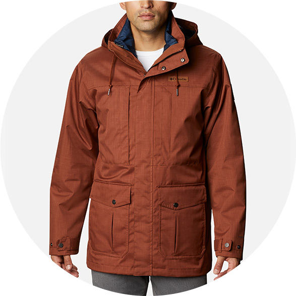 Man in a tan insulated jacket.