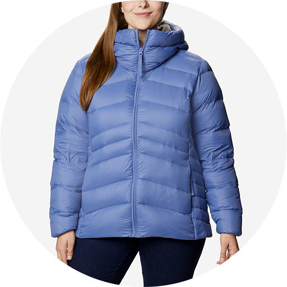 Woman in a plus size light blue insulated jacket.