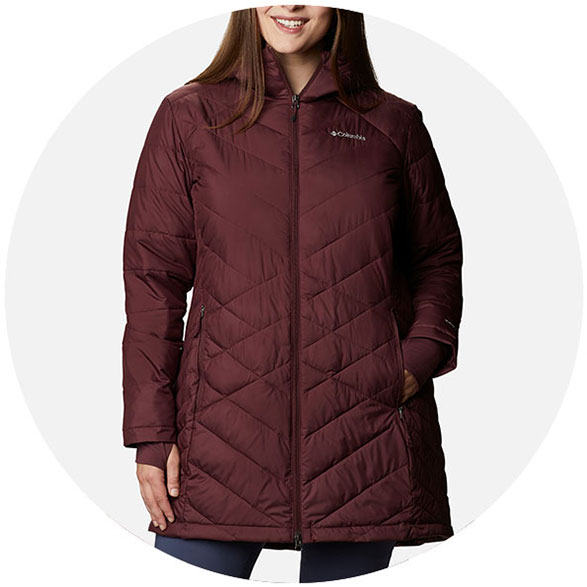 Woman in a plus size peach insulated jacket.