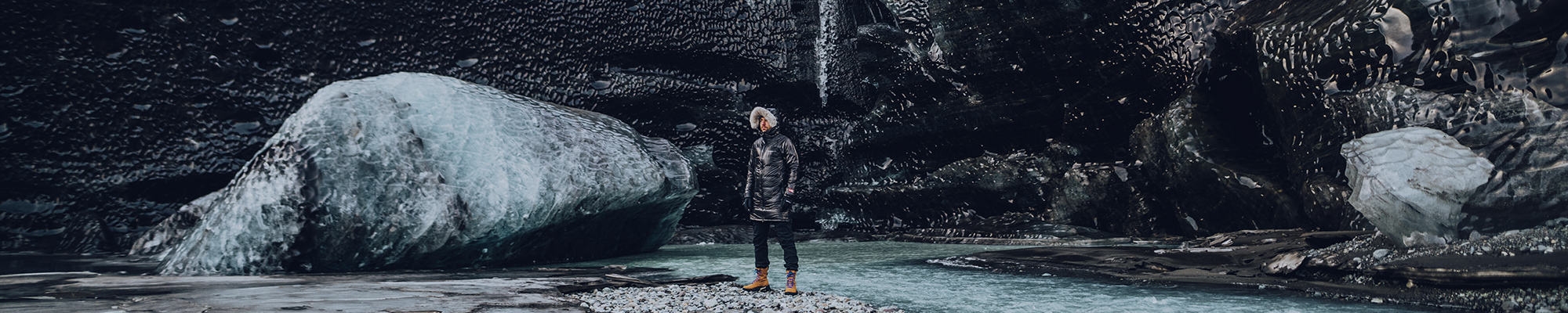 Man in a Black Dot parka in a frigid landscape.