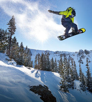 A snowboarder catching air.