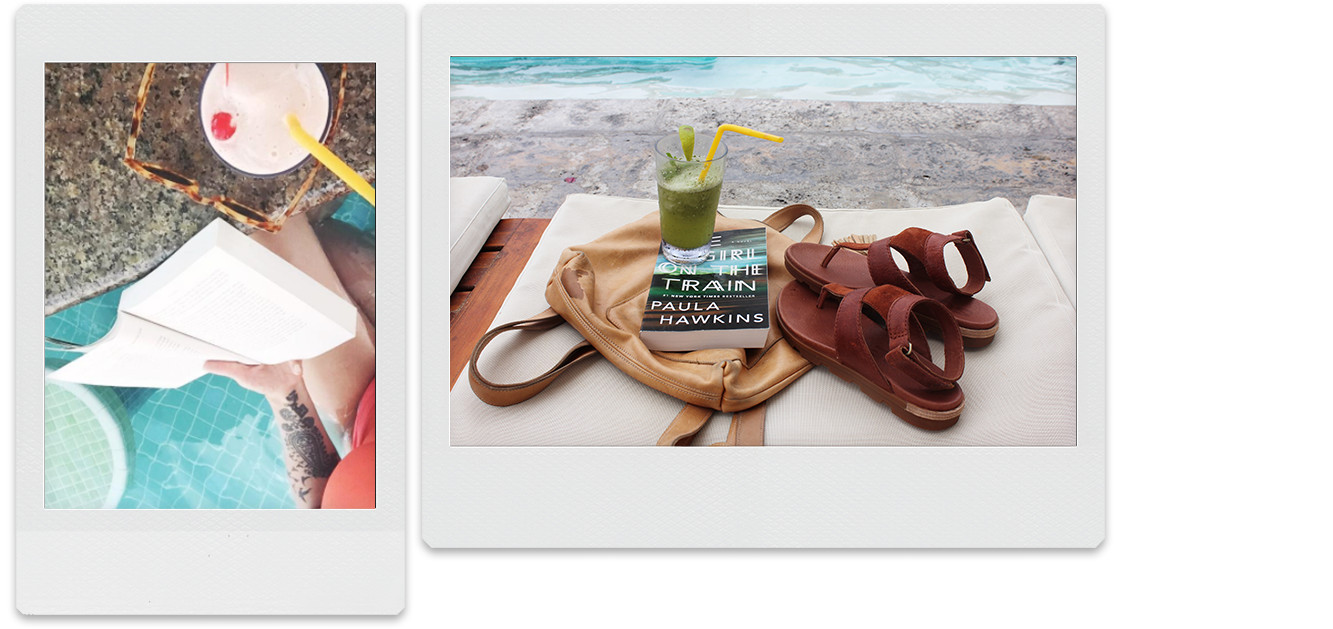 A picture of sandals, a cocktail, and a book sitting on the side of a pool.