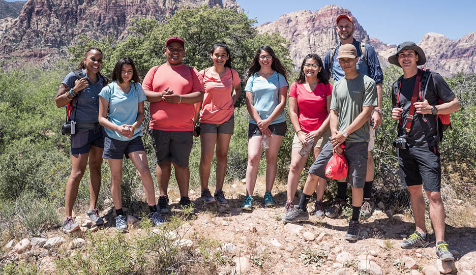 Mark and Faith pose with students; Video about hiking with students.
