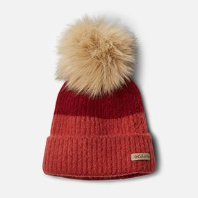 a red knit hat with a pompom
