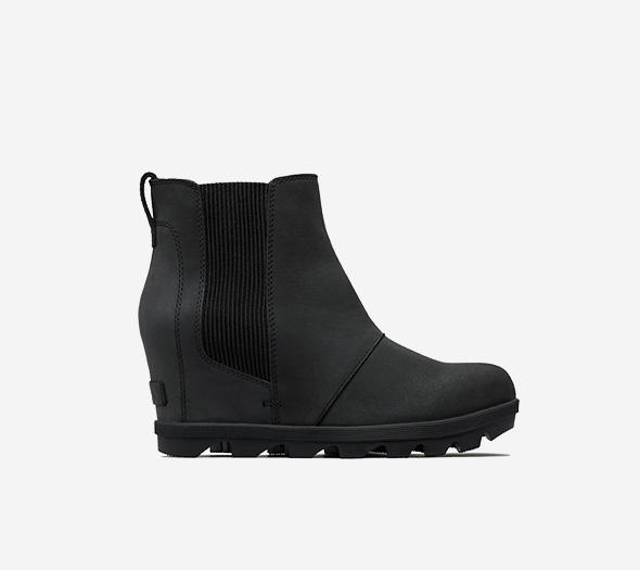 Profile view of a black  Joan Wedge Chelsea boot
